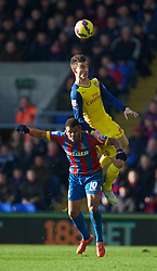 LONDON, ENGLAND - Saturday, February 21, 2015: Arsenal's Laurent Koscielny in action against Crystal Palace's Fraizer Campbell during the Premier League match at Selhurst Park. (Pic by David Rawcliffe/Propaganda)