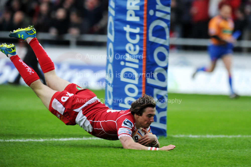 Rhodri Williams of the Scarlets dives in to score his sides 1st try. Rabodirect Pro12 rugby union match, Scarlets v Cardiff Blues at Parc y Scarlets in Llanelli, South Wales on Sat 10th May 2014.<br /> pic by Andrew Orchard, Andrew Orchard sports photography.