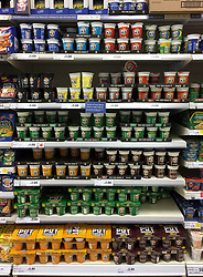 """Pot Noodles on sale in a Tesco store in Andover, Hampshire, as Unilever's finance chief admitted that the prices of its popular products will rise as a result of the collapse in sterling, a day after the firm was accused of """"exploiting consumers"""" following a row with Tesco."""