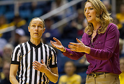 TCU Horned Frogs head coach Raegan Pebley argues with an official against the West Virginia Mountaineers at the WVU Coliseum.