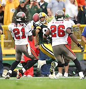 GREEN BAY, WI - SEPTEMBER 25:  Wide receiver Robert Ferguson #89 of the Green Bay Packers looks back for a pass that was tipped by cornerback Juran Bolden #21 and intercepted by safety Will Allen #26 of the Tampa Bay Buccaneers late in the game at Lambeau Field on September 25, 2005 in Green Bay, Wisconsin. The Buccaneers defeated the Packers 17-16. ©Paul Anthony Spinelli *** Local Caption *** Robert Ferguson;Juran Bolden;Will Allen