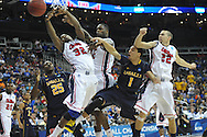 La Salle's Jerrell Wright (25), Ole Miss' Jarvis Summers (32), Ole Miss' Murphy Holloway (31), La Salle's D.J. Peterson (1), and Ole Miss' Marshall Henderson (22) go for the ball in the Round of 32 of the NCAA Tournament at the Sprint Center in Kansas City, Mo. on Sunday, March 24, 2013.