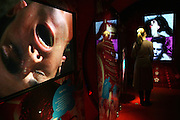 A woman is watching sex scenes on TV screens in the Orgasm Tunnel at Amora, the Academy of Sex and Relationships, on Tuesday, April 17, 2007, in London, UK. The world's first visitor attraction dedicated to love, sex and relationships opens its door officially tomorrow (18th of April 2007) in Piccadilly. The permanent interactive attraction, Amora, expects to draw over half a million, 18+ visitors in the first year and fuses entertainment, excitement and education in a unique powerful sensory experience. With seven zones covering every aspect of relationships from first filtrations and dating to fantasy and fetish. Visitors can explore the science of attraction - what they find attractive and why, learn how to enhance their skills and even create what their perfect partner might look like. Male and female models help demystify erogenous zones, G-spot and prostate, while insights and technique tips are offered on various topics. Sexual awareness and well-being are also covered thoroughly. **Italy Out**..