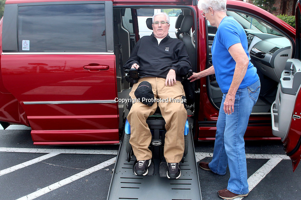 David Parrish is helped out of a converstion van by his mother June Parrish Saturday November 2, 2013 at Carrabba's Italian Grill in Wilmington, N.C. Parrish was in town to see his son Michael play soccer for UNCW who he hasn't seen play since 2011 after an accident left him paralyzed. (Jason A. Frizzelle)