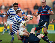 Fraser Tech captain Tyron Child tackled by Jarrod Bayliss during the Waikato Club Rugby Final - Fraser Tech v Morrinsville Sports, won 19-15 by Fraser Tech at Waikato Stadium, Hamilton, New Zealand, Saturday 31 July 2010. Photo: Stephen Barker/PHOTOSPORT