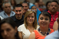 A new U.S. citizen smiles after she become a U.S. citizen during a naturalization ceremony at the Evo A. DeConcini U.S. Courthouse in Tucson, Arizona, U.S., on Friday, Sept. 16, 2016. Photographer: David Paul Morris/Bloomberg