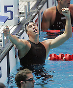 England's Simon Burnett celebrates winning the Mens 100m Freestyle Swimming Final at the Melbourne Sports and Aquatic centre at the XVIII Commonwealth Games, Melbourne, Australia, Sunday, March 19 2006. Photo: Michael Bradley/PHOTOSPORT
