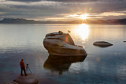 """Photographer at Bonsai Rock"" - Photograph of photographer Tony Spiker of www.SpikerPhotography.com shooting a sunset at Bonsai Rock, Lake Tahoe."