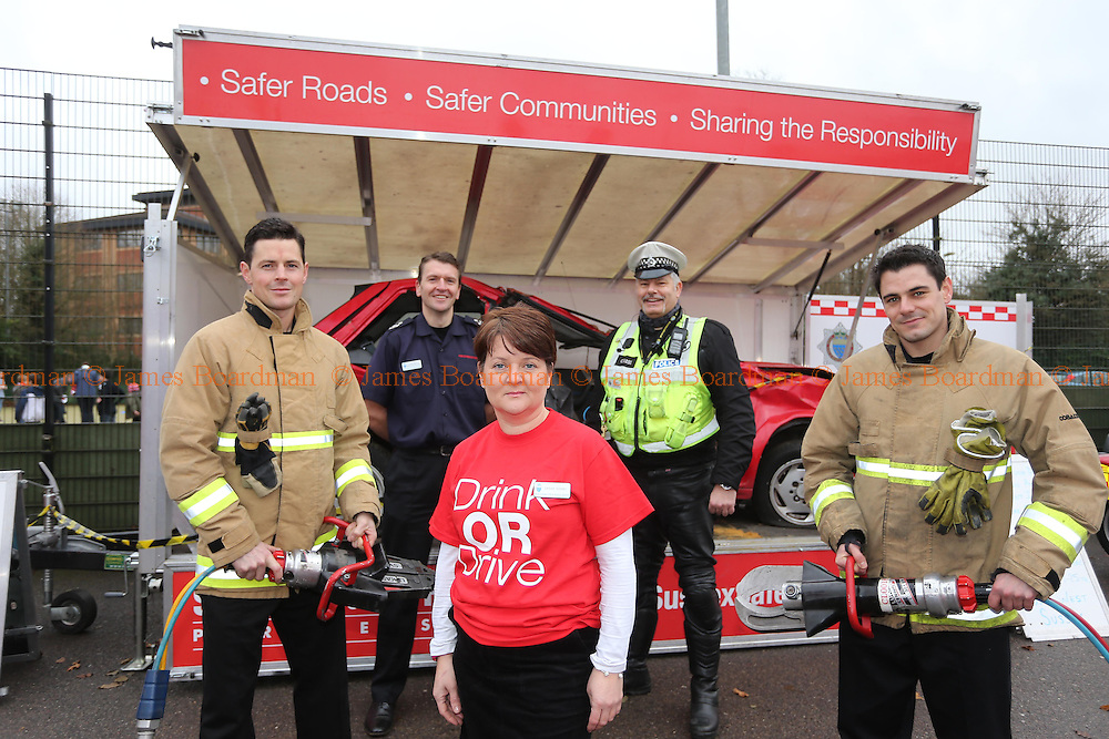 JAMES BOARDMAN / 07967642437<br /> L-R Fire Fighter Dan Wright, Gavin Watts [Ass Chief Fire Officer] Sarah Adams, Phil Barrow [Police Casualty Reduction Team] and Firefighter Tim Taylor all part of the  'drink or drive' campaign being promoted by The Fire and Police services and the Sussex Safer Roads Partnership, at the Checkatrade.com Stadium in Crawley. December 14, 2013.