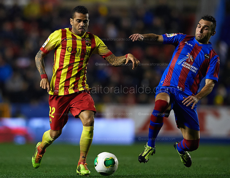 VALENCIA, SPAIN - JANUARY 2: (L) Dani Alves of FC Barcelona  is followed by (R) David Barral of Levante UD during the SM Copa del Rey between Levante UD and FC Barcelona de at the Ciutat de Valencia stadium January 22, 2014 in Valencia, Spain. (Photo by Aitor Alcalde).