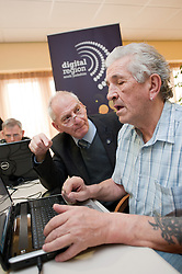 Digital Region Co-Running a series of workshops to equip the elderly with basic computer skills at Bakersfield Court sheltered housing on Longfellow Drive Rotherham- Ron Roberts is helped by Reg Margetts (left)..21 March 2011.Images © Paul David Drabble Digital Region Co-Running a series of workshops to equip the elderly with basic computer skills at Bakersfield Court sheltered housing on Longfellow Drive Rotherham<br />