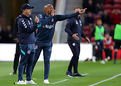 Middlesbrough manager Tony Pulis (left) and West Bromwich Albion manager Darren Moore gestures on the touchline during the Sky Bet Championship match at the Riverside Stadium, Middlesbrough.