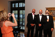 Maria Hanson of Centerville (left) takes a picture of friends as they gather for a group picture during the 56th Art Ball, 'Art is in the Air', at the Dayton Art Institute, Saturday, June 8, 2013.