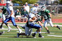 17 September 2011: Noah Martin gets sacked by Ryan Gesko during an NCAA Division 3 football game between the Aurora Spartans and the Illinois Wesleyan Titans on Wilder Field inside Tucci Stadium in.Bloomington Illinois.