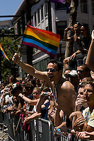 SAN FRANCISCO, CA - JUNE 24 : Michael A. Fiumara (C) of Santa Rosa watches the 37th annual LBGT Pride Parade on June 24, 2007 in San Francisco, California. Hundreds of thousands of people lined the streets of San Francisco to watch and take part in the parade.  (Photograph by David Paul Morris)