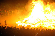 A sea of humanity floods in to the flaming pile of a man that was burned in effigy Saturday night in the culmination of the Burningman counter culture arts festival in the Black Rock Desert 100 miles north east of Reno, NV, Friday, Sept 3, 2004.