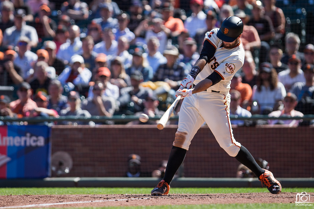 San Francisco Giants first baseman Brandon Belt (9) connects for a hit against the Arizona Diamondbacks at AT&T Park in San Francisco, Calif., on August 31, 2016. (Stan Olszewski/Special to S.F. Examiner)