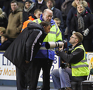 Picture by David Horn/Focus Images Ltd +44 7545 970036<br /> 03/12/2013<br /> Billy Davies , Manager of Nottingham Forest remonstrates with Nottingham based photographer Dan Westwell after the game for taking photos of the Bench during the Sky Bet Championship match at The Den, London.