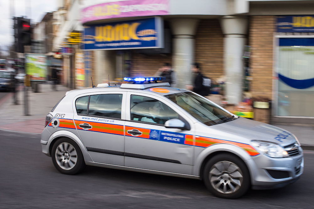 A Metropolitan Police car respond to an emergency in Stoke Newington, Hackney, London.