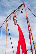 Trapeze aerial performance. Dun Laoghaire Dublin. ©Tamara Him.