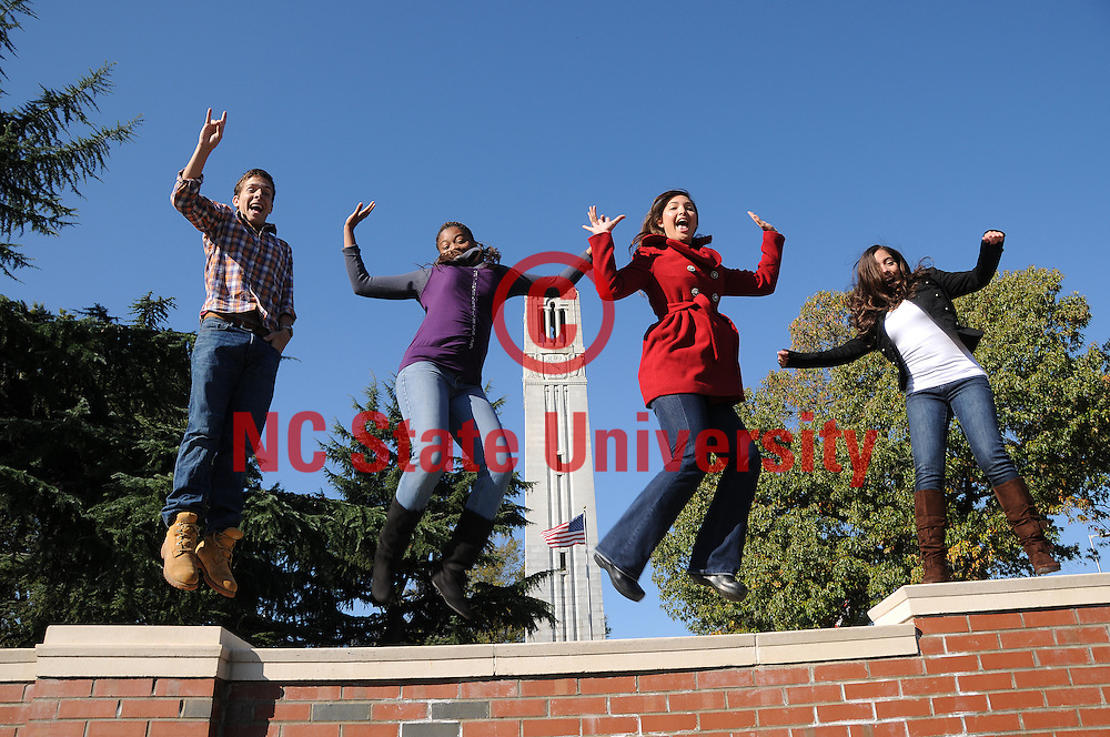 Students jump for joy at the Belltower.
