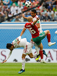 June 15, 2018 - Saint Petersburg, Russia - Noureddine Amrabat (C) of Morocco national team vies for the ball with Vahid Amiri (L) and Omid Ebrahimi of IR Iran national team during the 2018 FIFA World Cup Russia Group B match between Morocco and IR Iran on June 15, 2018 at Saint Petersburg Stadium in Saint Petersburg, Russia. (Credit Image: © Mike Kireev/NurPhoto via ZUMA Press)
