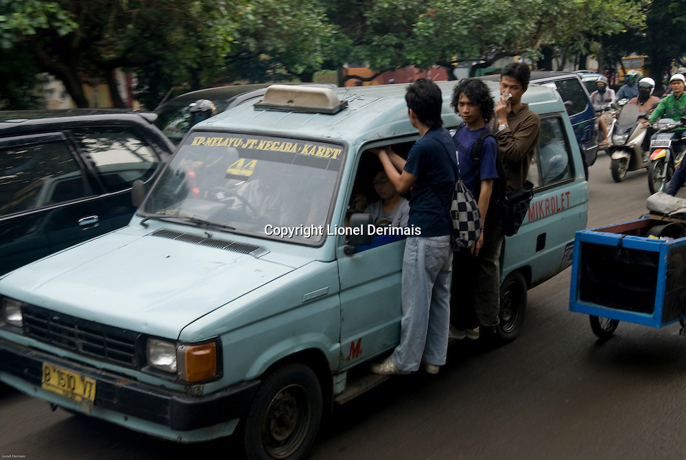 Jakarta taxi aka mikrolet at rush hour, Indonesia.