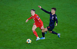 CARDIFF, WALES - Sunday, October 13, 2019: Wales' Harry Wilson (L) is tackled by Croatia's Ivan Perišić during the UEFA Euro 2020 Qualifying Group E match between Wales and Croatia at the Cardiff City Stadium. (Pic by Paul Greenwood/Propaganda)
