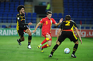Adam Matthews of Wales © goes past Belgium's Marouane Fellaini (l) and Guillaume Gillet (2). World cup 2014 qualifying match, Group A, Wales v Belgium at the Cardiff city stadium in Cardiff, South Wales on Friday 7th Sept 2012.  pic by  Andrew Orchard, Andrew Orchard sports photography,