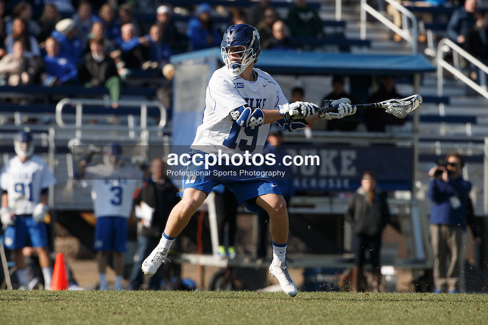 DURHAM, NC - FEBRUARY 08: Christian Walsh #19 of the Duke Blue Devils plays against the Jacksonville Dolphins on February 08, 2014 at Koskinen Stadium in Durham, North Carolina. Duke won 16-10.