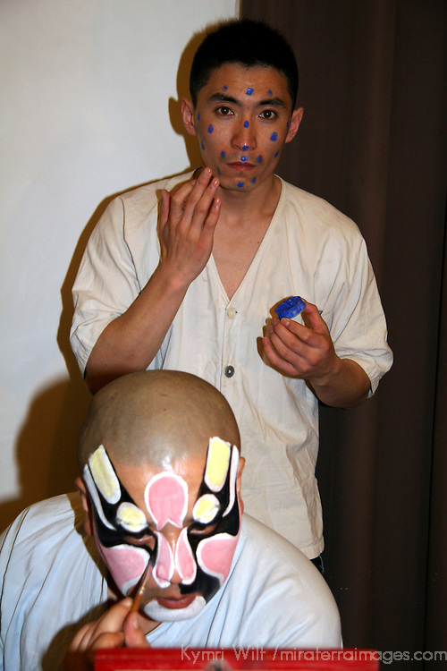 Asia, China, Beijing. Performers prepare backstage at the Beijing Opera