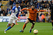 Blackburn Rovers midfielder Ben Marshall and Wolverhampton Wanderers midfielder Jack Price battle for the ball during the Sky Bet Championship match between Wolverhampton Wanderers and Blackburn Rovers at Molineux, Wolverhampton, England on 9 April 2016. Photo by Alan Franklin.