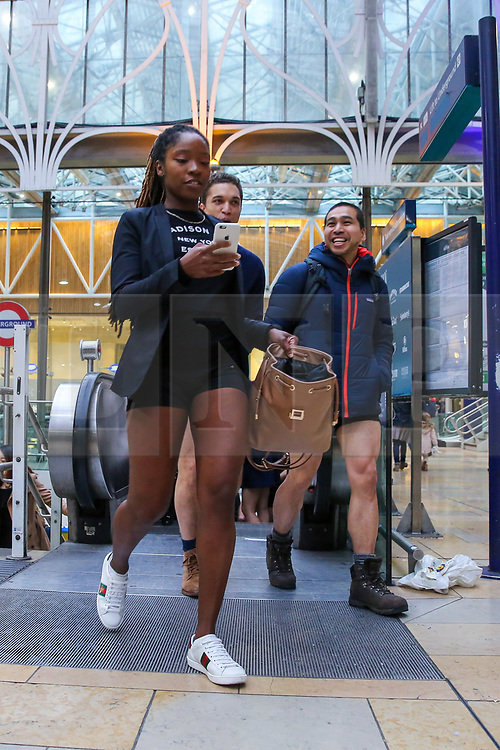 """© Licensed to London News Pictures. 13/01/2019. London, UK. Participants take part in 10th anniversary of 'No Trousers Tube Ride' event by arriving at Paddington Station.  The """"No Pants Subway Ride"""" is an annual event staged by Improve Everywhere every January in New York City. The mission started as a small prank with seven guys and has grown into an international celebration of silliness, with dozens of cities including London around the world participating each year. Photo credit: Dinendra Haria/LNP"""
