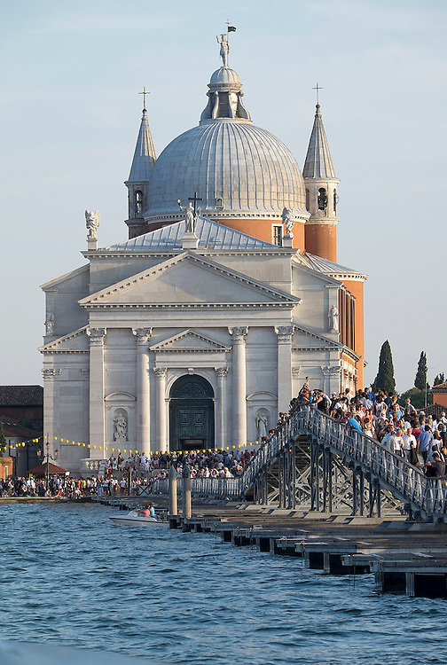 VENICE, ITALY - JULY 19:  Pilgrims cross the votive bridge to the Redentore Church on July 19, 2014 in Venice, Italy. Redentore , which is in remembrance of the end of the 1577 plague, is one of Venice's most loved celebrations. Highlights of the celebration include the pontoon bridge extending across the Giudecca Canal, gatherings on boats in the St. Mark's Basin and a spectacular fireworks display.  (Photo by Marco Secchi/Getty Images)