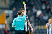 Notts County defender Shaun Brisley (16) is booked and receives a caution and a yellow card for dissent during the EFL Sky Bet League 2 match between Notts County and Wycombe Wanderers at Meadow Lane, Nottingham, England on 30 March 2018. Picture by Simon Davies.