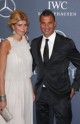 RUUD GULLIT AND ESTELLE CRUYFF arrives at the Laureus Sport Awards held at the Queen Elizabeth II Centre, London, Monday February 6, 2012. Photo By i-Images