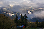 Sun shines on the snow covered hills off of Highway 20, or the North Cascades Highway, in Skagit County, Wash. (Erika Schultz / The Seattle Times)