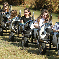 Adam Robison | BUY AT PHOTOS.DJOURNAL.COM<br /> Students from Classical Conversations in Corinth, ride the Cow Train as they visit the Pumpkin Patch at the Tupelo Buffalo Park and Zoo Monday morning in Tupelo.