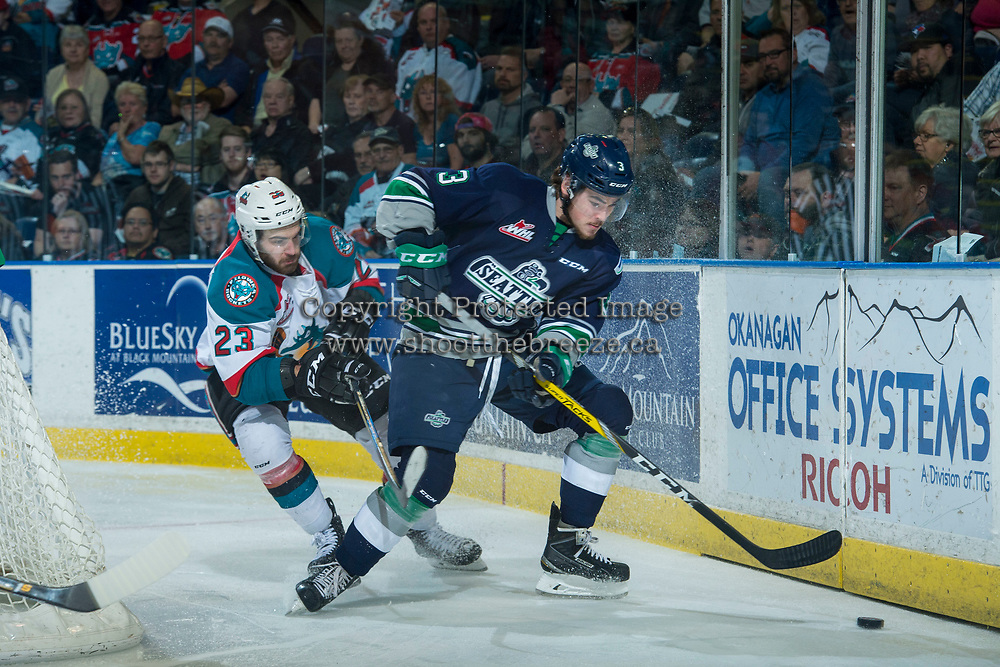 KELOWNA, CANADA - APRIL 26: Reid Gardiner #23 of the Kelowna Rockets back checks Anthony Bishop #3 of the Seattle Thunderbirds behind the net on April 26, 2017 at Prospera Place in Kelowna, British Columbia, Canada.  (Photo by Marissa Baecker/Shoot the Breeze)  *** Local Caption ***