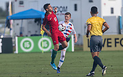 Portugal midfielder Marco Cruz (10) receives a pass while Team USA midfielder Evan Rotundo (10) prepares to tackle during a CONCACAF boys under-15 championship soccer game, Saturday, August 10, 2019, in Bradenton, Fla. Portugal defeated Team USA 3-0 and advanced to the finals against Slovenia. (Kim Hukari/Image of Sport)