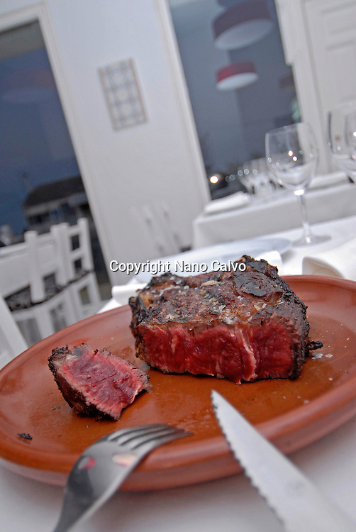 Thick beef meat cooked on a grill, at a restaurant