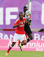 Portugal, FUNCHAL :Benfica's Brazilian midfielder Talisca  vies with Nacional´s Guinean midfielder Boubacar during the Portuguese league football match CD Nacional vs Benfica at the Madeira stadium in Funchal on November 09, 2014.  AFP PHOTO / GREGORIO CUNHA