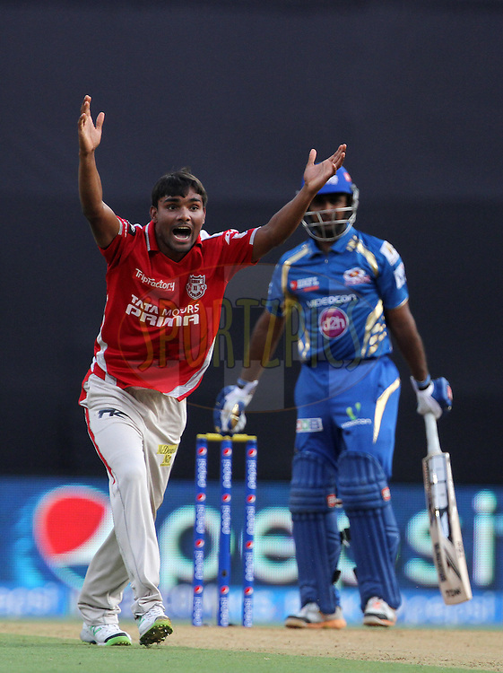 Sandeep Sharma of the Kings X1 Punjab celebrates after taking the wicket Ambati Rayudu of the Mumbai Indians  during match 22 of the Pepsi Indian Premier League Season 2014 between the Mumbai Indians and the Kings XI Punjab held at the Wankhede Cricket Stadium, Mumbai, India on the 3rd May  2014<br /> <br /> Photo by Vipin Pawar / IPL / SPORTZPICS<br /> <br /> <br /> <br /> Image use subject to terms and conditions which can be found here:  http://sportzpics.photoshelter.com/gallery/Pepsi-IPL-Image-terms-and-conditions/G00004VW1IVJ.gB0/C0000TScjhBM6ikg