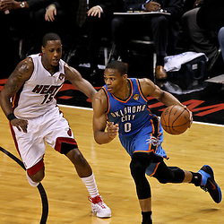 Jun 21, 2012; Miami, FL, USA; Oklahoma City Thunder point guard Russell Westbrook (0) drives past Miami Heat point guard Mario Chalmers (15) during the first quarter in game five in the 2012 NBA Finals at the American Airlines Arena. Mandatory Credit: Derick E. Hingle-US PRESSWIRE