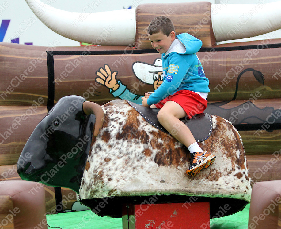 4/8/13 Conor Fennell was enjoying the Bucking Bronco at the Cooraclare Field Day. Pic Tony Grehan