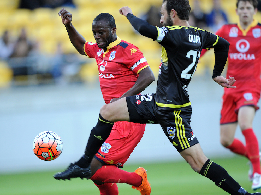Adelaide United's Bruce Djite, left, contests the ball with Phoenix's Andrew Durante in the A-League football match at Westpac Stadium, Wellington, New Zealand, Friday, November 13, 2015. Credit:SNPA / Ross Setford