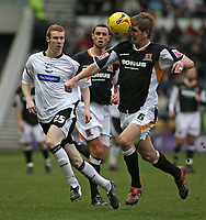 Photo: Pete Lorence.<br />Derby County v Hull City. Coca Cola Championship. 10/02/2007.<br />Phil Turner heads the ball forwards past Stephen Pearson.