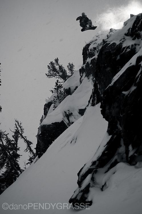 a moody black and white photo of professional snowboarder Shin Campos on Whistler Mountain, British Columbia.