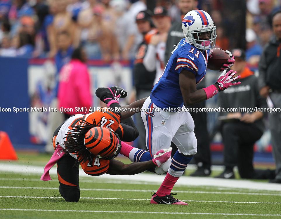 13 October 2013: Cincinnati Bengals cornerback Adam Jones (24) misses a tackle on Buffalo Bills wide receiver T.J. Graham (11) during a NFL game between the Cincinnati Bengals and Buffalo Bills at Ralph Wilson Stadium in Orchard Park, NY.