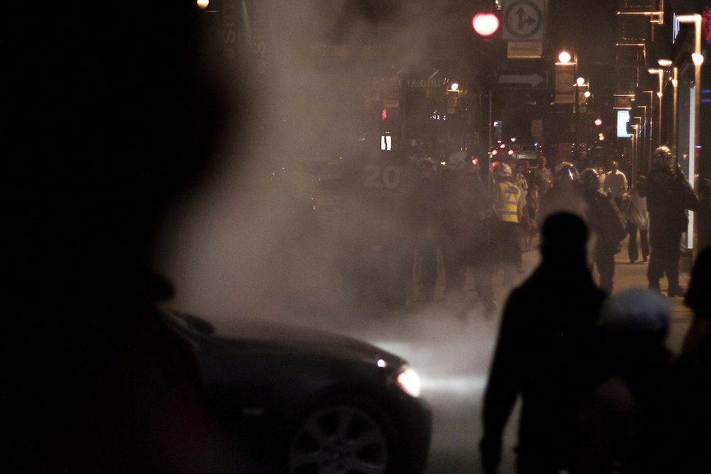 Teargas and smoke from homemade smokebomb clouds the air as demonstrators and riot police clash during F1 weekend protest. Quebec Spring / Printemps Érable.
